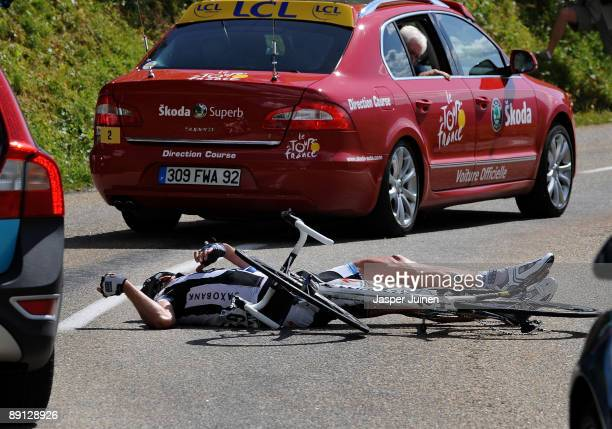 Jens Voigt of Germany and team Saxo Bank lies on the road after falling in the descend of the Col du Petit-Saint-Bernard during stage 16 of the 2009...