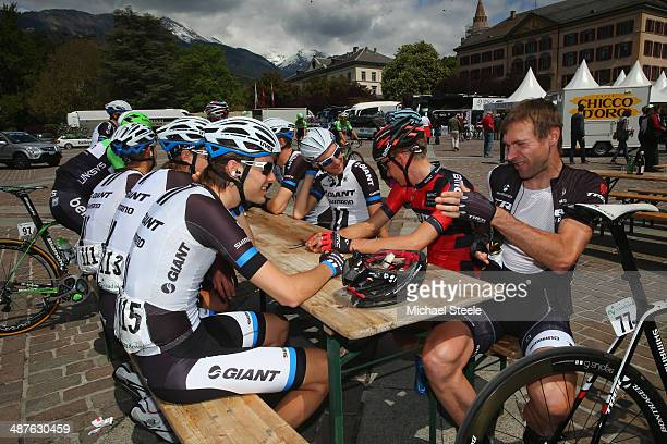 Jens Voigt of Germany and Trek Factory Racing chats with Georg Preidler of Austria and Team GiantShimano ahead of stage two of the Tour de Romandie...