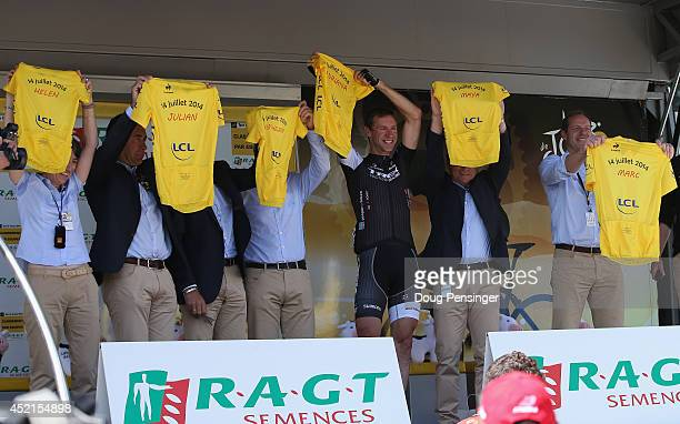 Jens Voigt of Germany and Trek Factory Racing is honored by race director Christian Prudhomme with yellow jerseys for his six children as Voigt is...