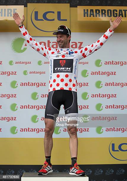 Jens Voigt of Germany and Trek Factory Racing takes the podium after being named the most aggressive rider and winning the king of the mountains...