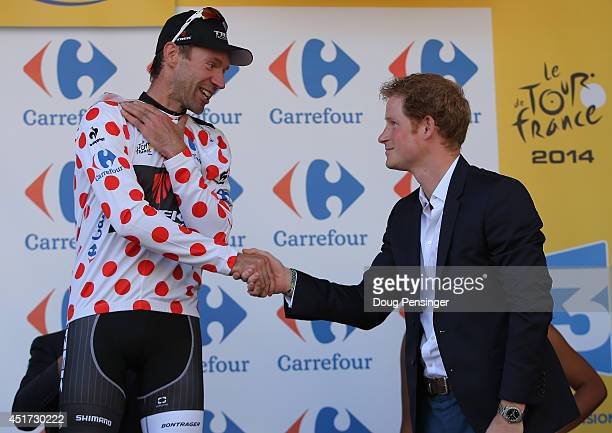 Jens Voigt of Germany and Trek Factory Racing takes the podium and is awarded the king of the mountains polka dot hersey by Prince Harry after stage...