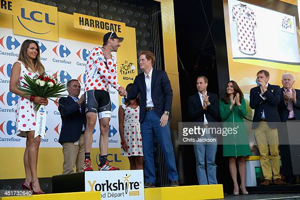 Jens Voigt of Germany and Trek Factory Racing takes the podium and is awarded the king of the mountains polka dot jersey by Prince Harry as Prince...