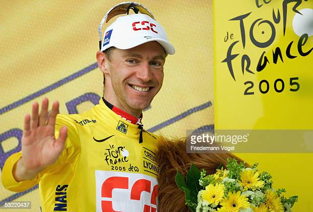 Jens Voigt of Germany from the CSC Team celebrates on the podium after earning the yellow jersey on the stage 9 of the 92nd Tour de France between...