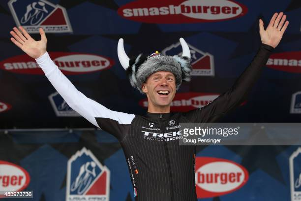 Jens Voigt of Germany riding for Trek Factory Racing acknowledges the support of his fans after he was given an Ullr Helmet as a retirement gift by...