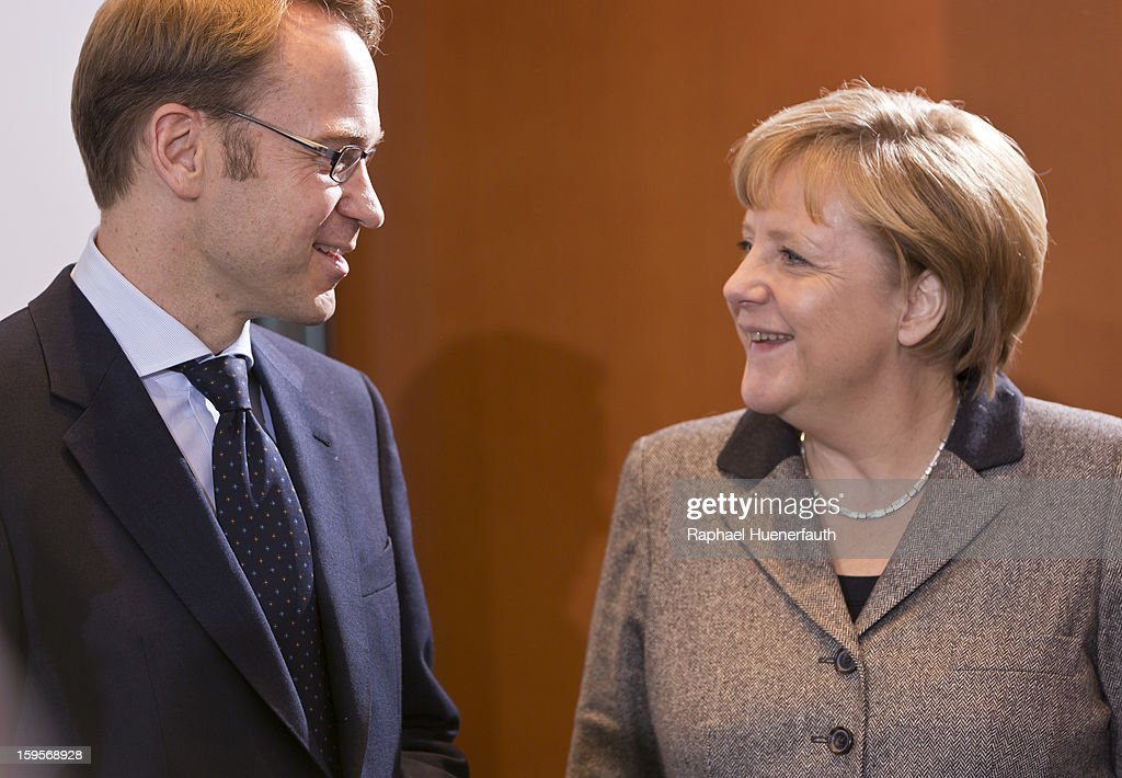 Jens Weidmann (L), president Deutsche Bundesbank and German Chancellor Angela Merkel (R) arrive for the weekly German government cabinet meeting on January 16, 2013 in Berlin, Germany.