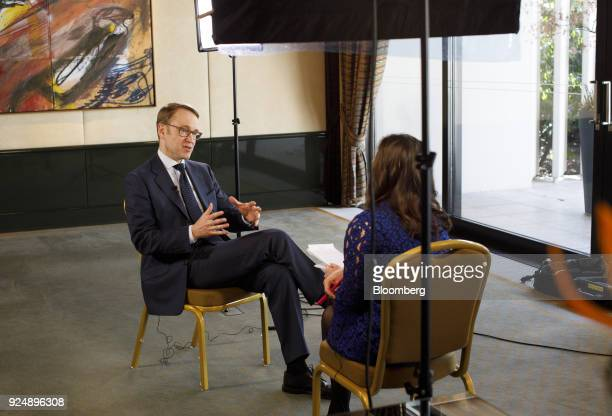 Jens Weidmann president of the Deutsche Bundesbank gestures while speaking during a Bloomberg Television interview following news conference to...