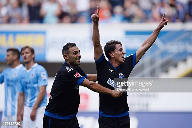 Jens Wemmer of SC Paderborn celebrates with teammate Mahir Saglik after heading his team's first goal during the Second Bundesliga match between SC...