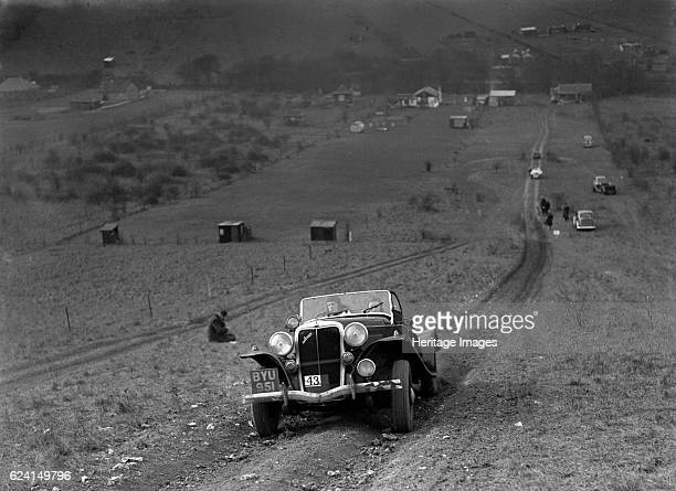 Jensen V8 competing in the London Motor Club Coventry Cup Trial Knatts Hill Kent 1938 Artist Bill BrunellJensen V8 Vehicle Reg No BYU951 Event Entry...