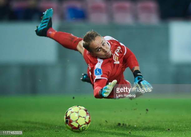 Jens-Lys Cajuste of FC Midtjylland scores the 2-1 goal against Goalkeeper Patrik Carlgren of Randers FC during the Danish 3F Superliga match between...