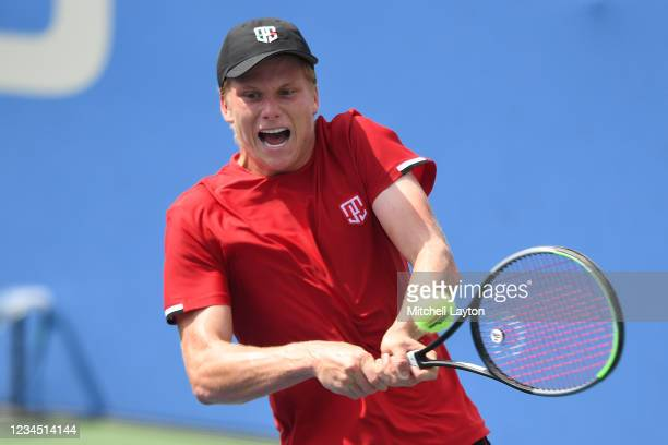 Jenson Brooksby of the United States returns a shot during a quarter final match against John MIllman of Australia on Day 7 during the Citi Open at...