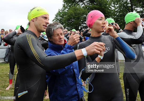 Jenson Button and girlfriend Jessica Michibata receive instructions from a course marshall prior to the swim start during the GE Blenheim Triathlon...