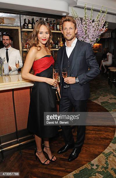 Jenson Button and Jessica Michibata attend the 'Icons of Style' dinner hosted by Michael Kors and Vanity Fair on May 14 2015 in London United Kingdom
