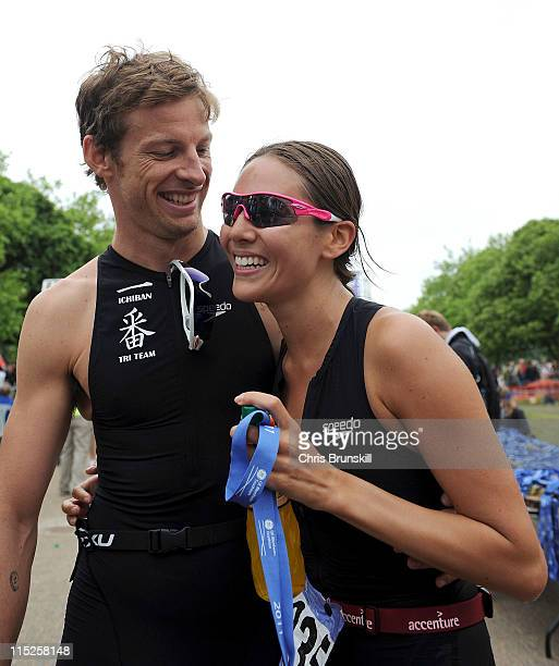 Jenson Button congratulates girlfriend Jessica Michibata after she crossed the finish line during the GE Blenheim Triathlon at Blenheim Palace on...