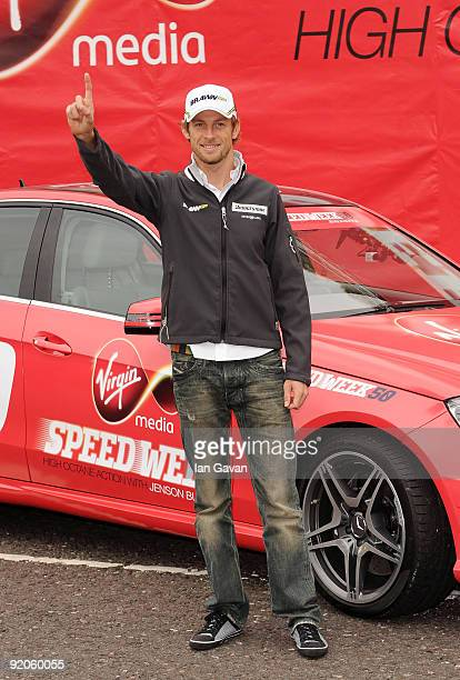 Jenson Button Formula 1 World Champion attends a photocall to promote Virgin Media's Speedweek50 broadband service at Bluewater shopping center on...