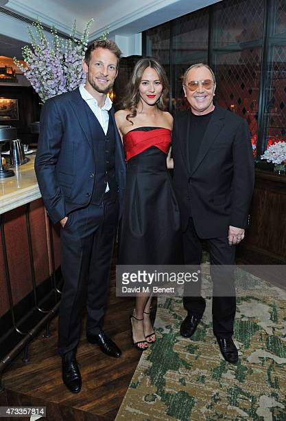 Jenson Button Jessica Michibata and Michael Kors attend the 'Icons of Style' dinner hosted by Michael Kors and Vanity Fair on May 14 2015 in London...