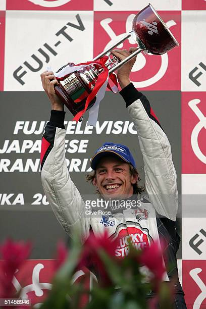 Jenson Button of Gereat Britain and BAR celebrates on the podium after the Formula One Japanese Grand Prix at Suzuka Circuit on October 10 2004 in...