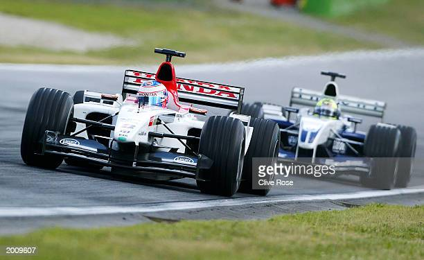 Jenson Button of Great Britain and BAR ahead of Ralf Schumacher of Germany and Williams BMW during the Austrian Grand Prix on May 18, 2003 at the A1...