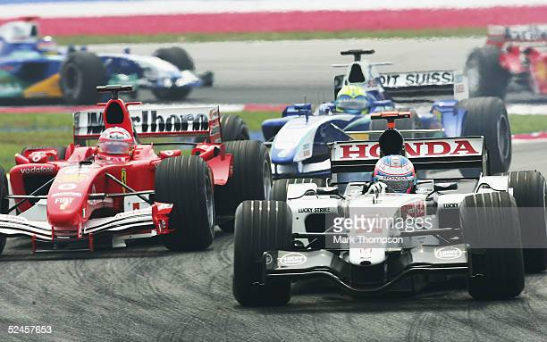 Jenson Button of Great Britain and BAR battles with Rubens Barrichello of Brazil and FerrariJenson Button of Great Britain and BAR during the...