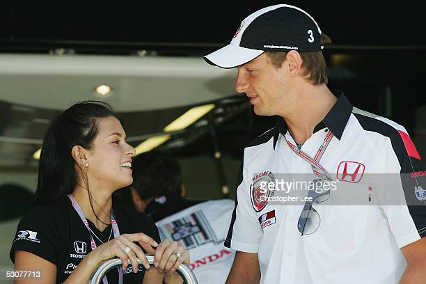 Jenson Button of Great Britain and BAR talks to IRL race driver Danica Patrick of USA during a photo opportunity as part of previews for the United...
