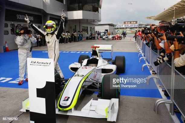 Jenson Button of Great Britain and Brawn GP celebrates in parc ferme after taking pole position during qualifying for the Malaysian Formula One Grand...