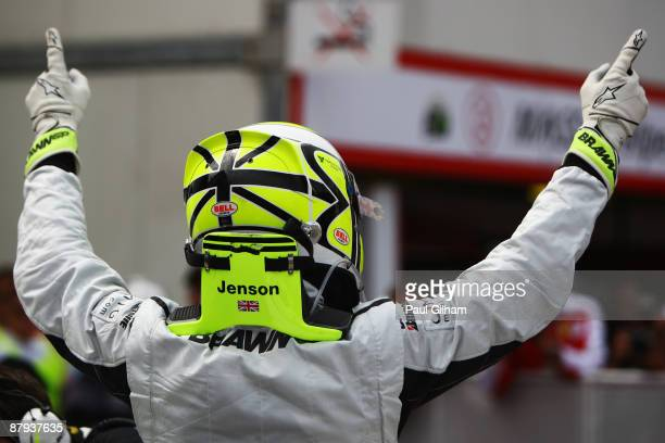 Jenson Button of Great Britain and Brawn GP celebrates in parc ferme after taking pole position during qualifying for the Monaco Formula One Grand...
