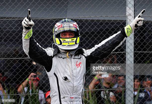 Jenson Button of Great Britain and Brawn GP celebrates in parc ferme after clinching the F1 World Drivers Championship during the Brazilian Formula...