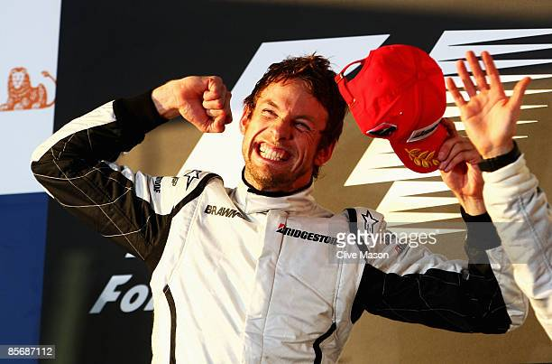 Jenson Button of Great Britain and Brawn GP celebrates on the podium after winning the Australian Formula One Grand Prix at the Albert Park Circuit...