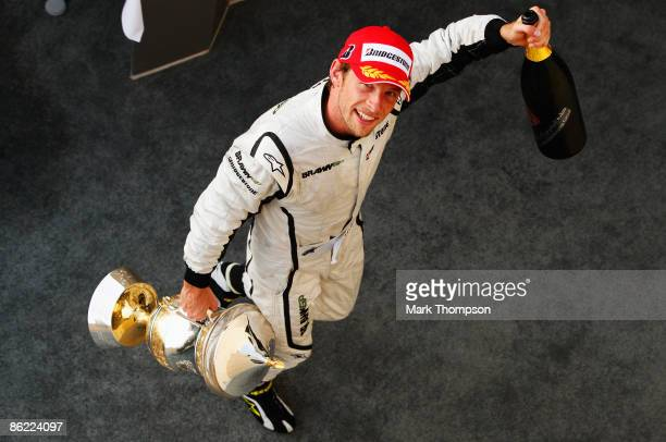 Jenson Button of Great Britain and Brawn GP celebrates on the podium after winning the Bahrain Formula One Grand Prix at the Bahrain International...
