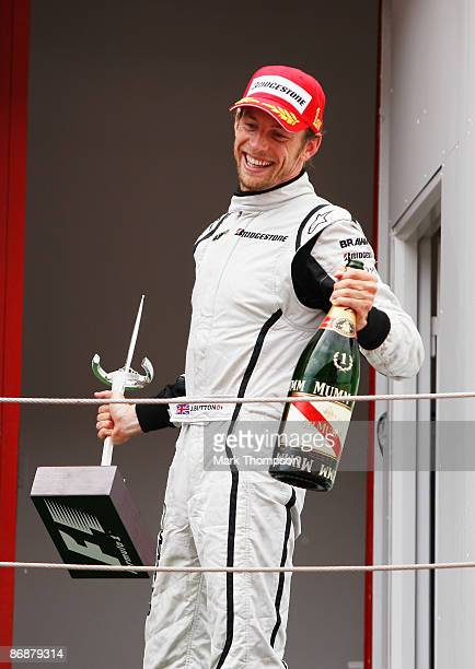 Jenson Button of Great Britain and Brawn GP celebrates on the podium as he wins the Spanish Formula One Grand Prix at the Circuit de Catalunya on May...
