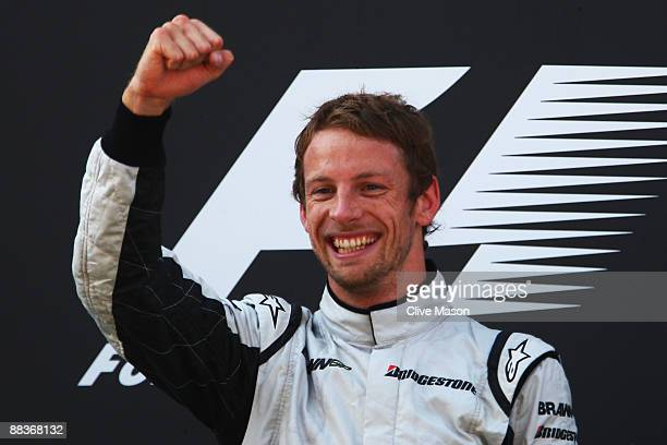 Jenson Button of Great Britain and Brawn GP celebrates on the podium after winning the Turkish Formula One Grand Prix at Istanbul Park on June 7 in...