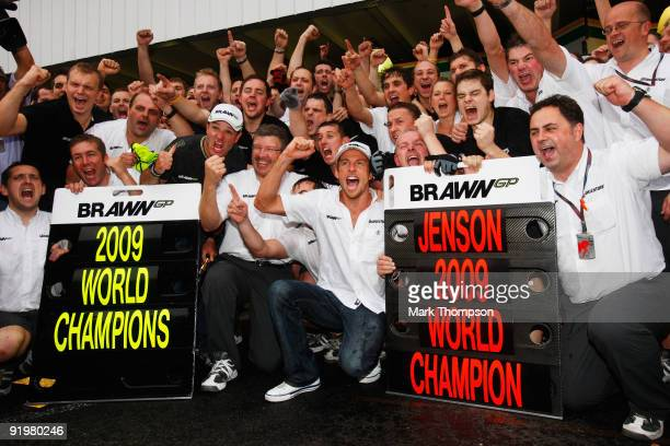 Jenson Button of Great Britain and Brawn GP celebrates with team mates as he wins the World Drivers Championship and Brawn GP win the Constructors...