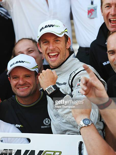 Jenson Button of Great Britain and Brawn GP celebrates with team mates in the paddock after winning the Turkish Formula One Grand Prix at Istanbul...