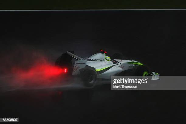 Jenson Button of Great Britain and Brawn GP drives in the rain during the Malaysian Formula One Grand Prix at the Sepang Circuit on April 5 2009 in...