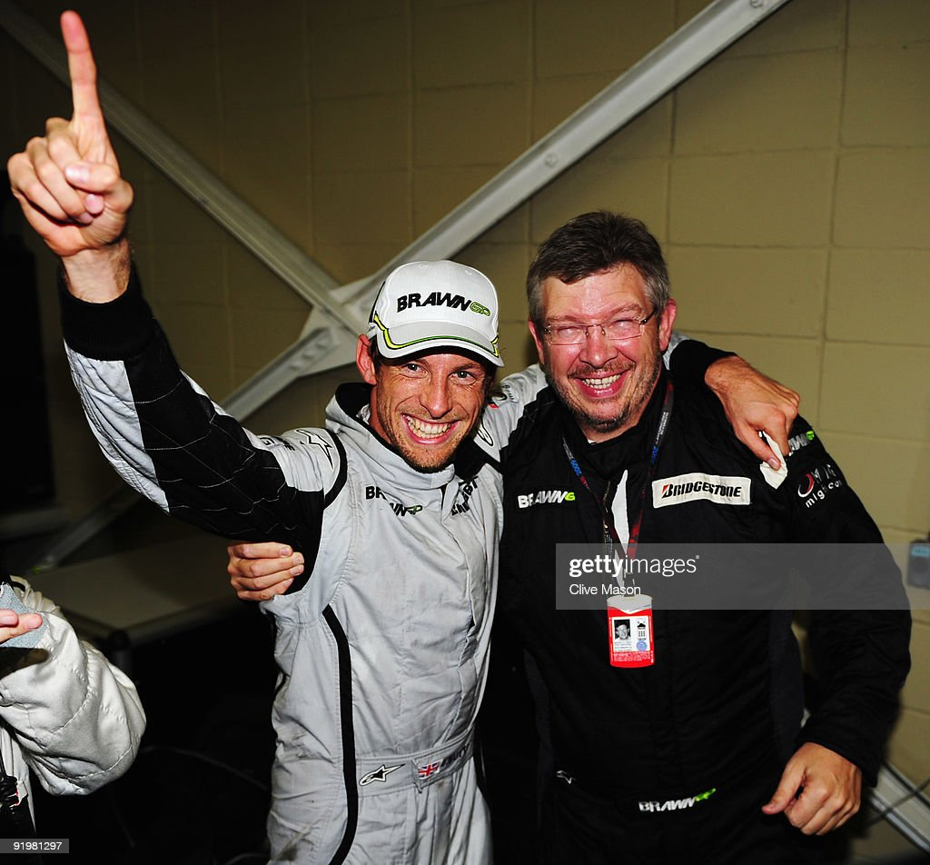 Jenson Button (L) of Great Britain and Brawn GP is congratulated by Team Principal Ross Brawn (R) after clinching the F1 World Drivers Championship during the Brazilian Formula One Grand Prix at the Interlagos Circuit on October 18, 2009 in Sao Paulo, Brazil.