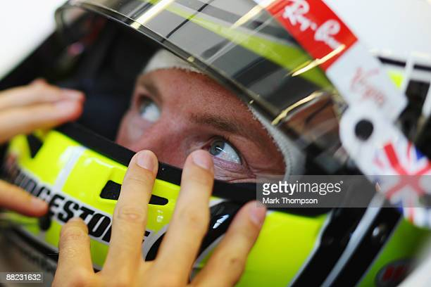 Jenson Button of Great Britain and Brawn GP is seen in his team garage during practice for the Turkish Formula One Grand Prix at Istanbul Park on...