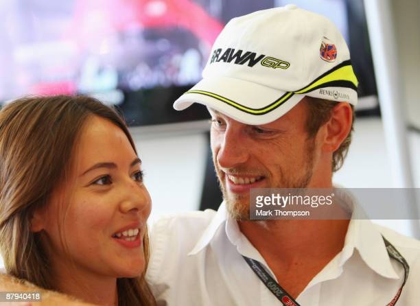 Jenson Button of Great Britain and Brawn GP is seen with his girlfriend Jessica Michibata following qualifying for the Monaco Formula One Grand Prix...