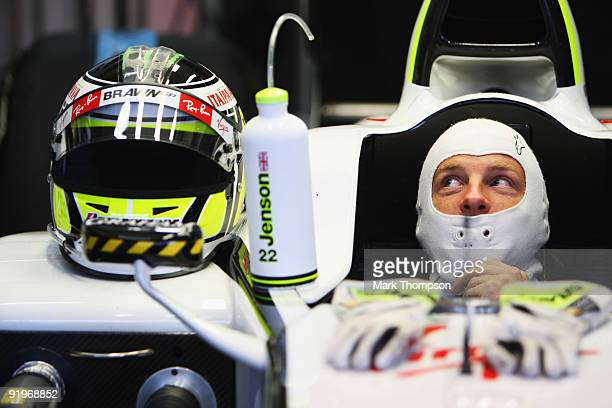 Jenson Button of Great Britain and Brawn GP prepares to drive in the rain delayed qualifying session for the Brazilian Formula One Grand Prix at the...