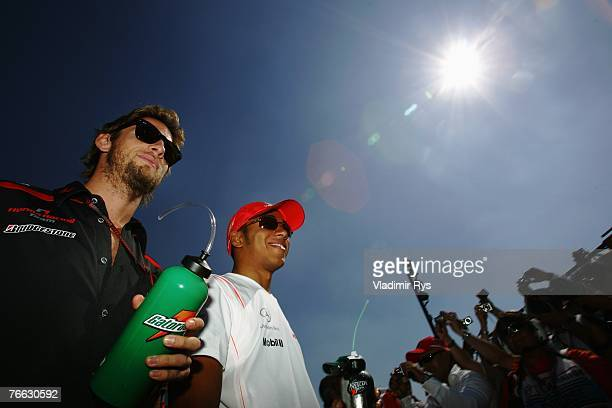 Jenson Button of Great Britain and Honda Racing and Lewis Hamilton of Great Britain and McLaren Mercedes appear at the drivers parade before the...