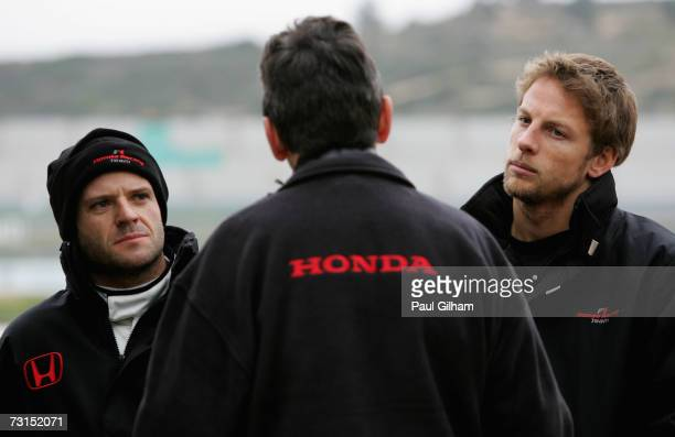 Jenson Button of Great Britain and Honda Racing and Rubens Barrichello of Brazil and Honda Racing talk to a Honda engineer during Formula One testing...