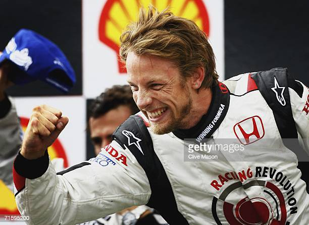 Jenson Button of Great Britain and Honda Racing celebrates victory on the podium after the Hungarian Formula One Grand Prix at the Hungaroring on...