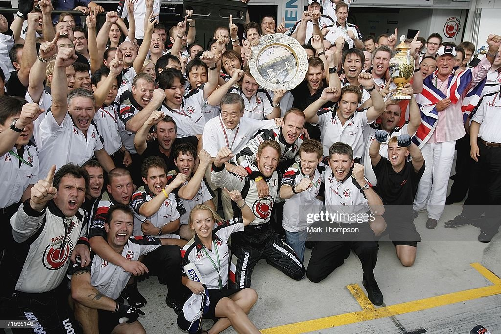 Jenson Button of Great Britain and Honda Racing celebrates victory with his team during the Hungarian Formula One Grand Prix at the Hungaroring on August 6, 2006 in Budapest, Hungary.