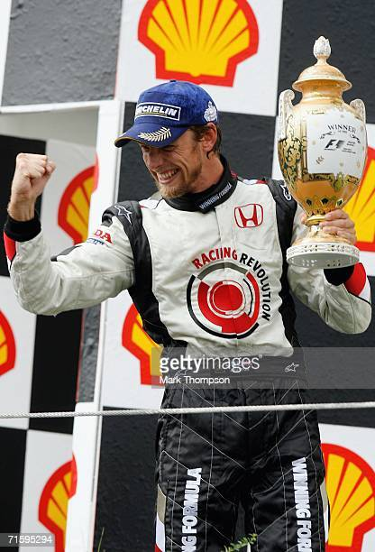 Jenson Button of Great Britain and Honda Racing celebrates victory during the Hungarian Formula One Grand Prix at the Hungaroring on August 6, 2006...