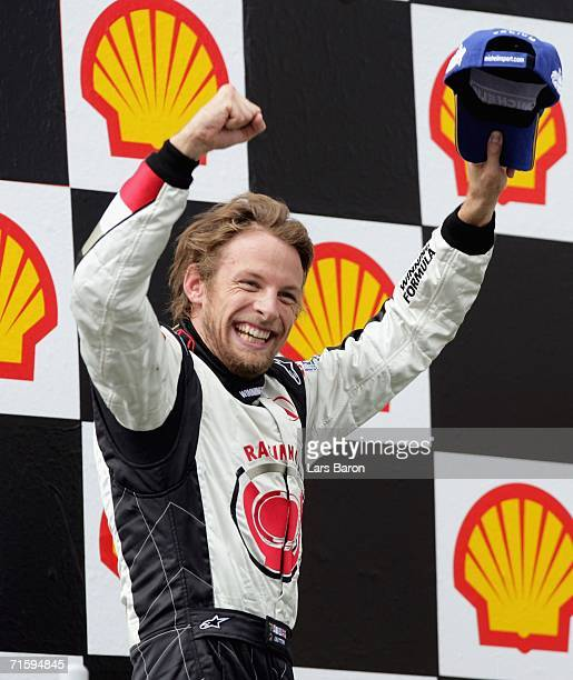 Jenson Button of Great Britain and Honda Racing celebrates winning the Hungarian Formula One Grand Prix at the Hungaroring on August 6 2006 in...