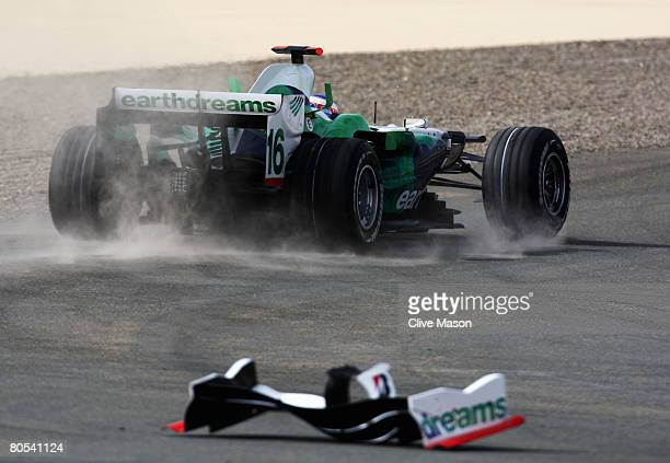 Jenson Button of Great Britain and Honda Racing drives off after colliding with David Coulthard of Great Britain and Red Bull Racing during the...