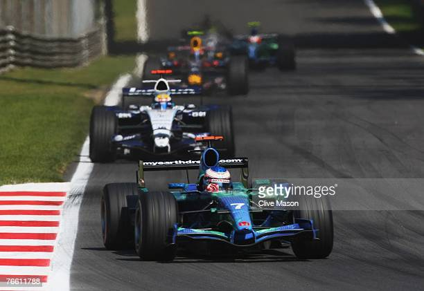 Jenson Button of Great Britain and Honda Racing leads from Nico Rosberg of Germany and Williams during the Italian Formula One Grand Prix at the...