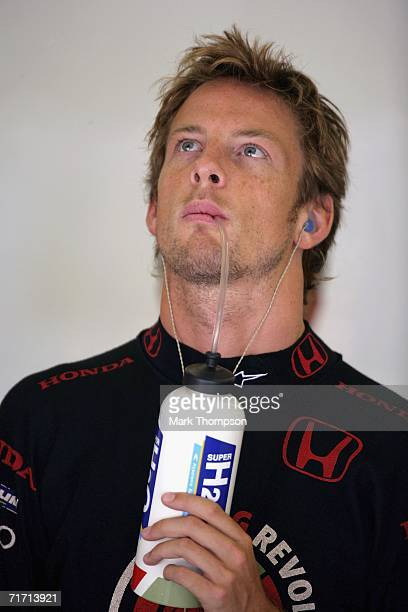 Jenson Button of Great Britain and Honda Racing looks on in the pits during first practice for the Turkish Formula One Grand Prix at the Istanbul...