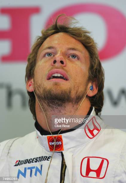 Jenson Button of Great Britain and Honda Racing studies the lap times during practice for the French Formula One Grand Prix at the Circuit de Nevers...