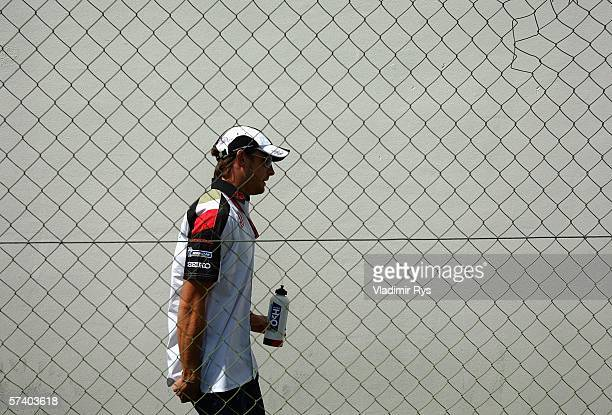 Jenson Button of Great Britain and Honda Racing walks in the paddock after the drivers parade prior to the San Marino Formula One Grand Prix at the...