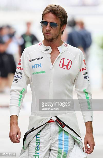 Jenson Button of Great Britain and Honda Racing walks through the paddock during qualifying for the European Formula One Grand Prix at the Valencia...