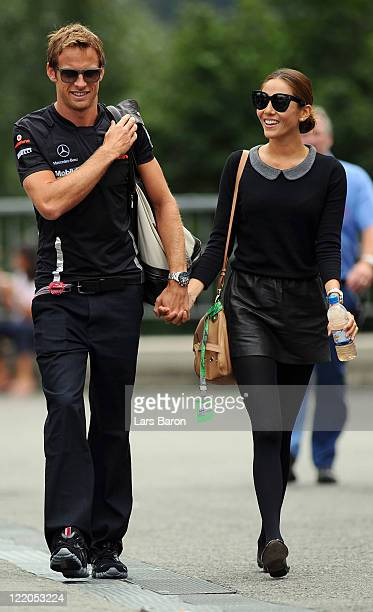 Jenson Button of Great Britain and McLaren and his girlfriend Jessica Michibata arrive in the paddock during previews to the Belgium Formula One...